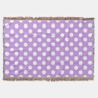 White polka dots on lilac throw blanket