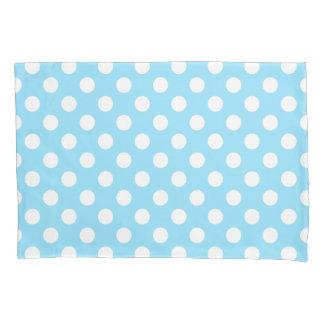 White polka dots on pale blue pillowcase