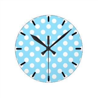 White polka dots on pale blue wallclocks