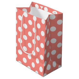 White polka dots on peach medium gift bag