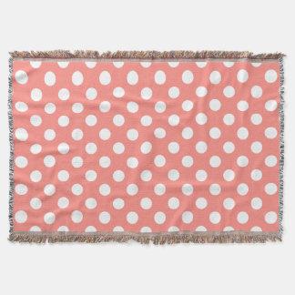 White polka dots on peach throw blanket