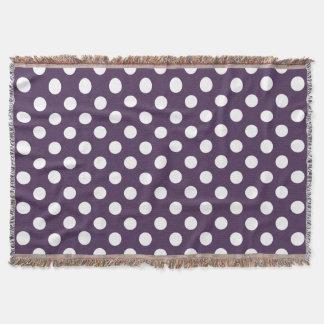 White polka dots on plum purple throw blanket