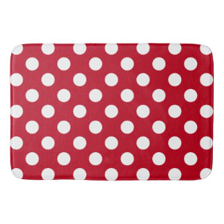 White polka dots on red bathroom mat