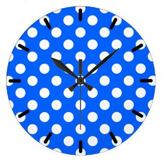 White polka dots on royal blue clocks
