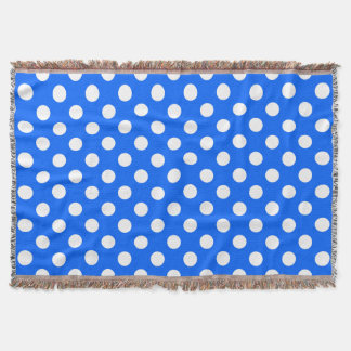 White polka dots on royal blue throw