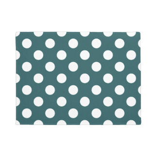 White polka dots on teal doormat