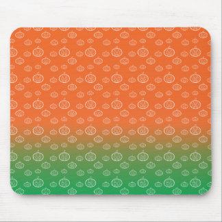 White pumpkin pattern on orange green fade mouse pads