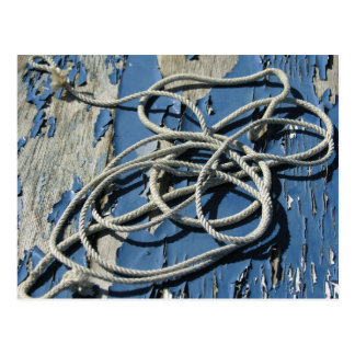 White rope on a blue boat with flaking paint postcard