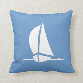 white sailboat on blue pillow
