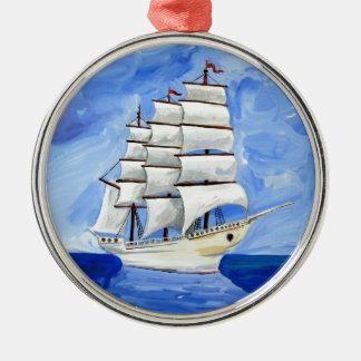 white sailboat on blue sea metal ornament