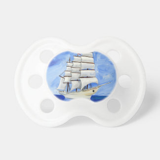 white sailboat on blue sea pacifier