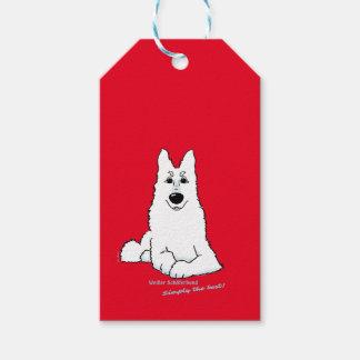 White shepherd dog lying gift tags