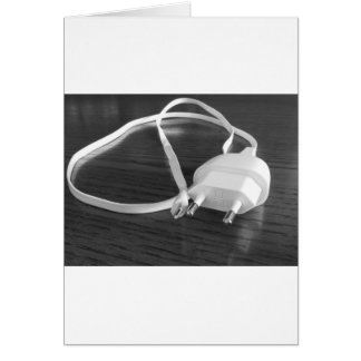 White smartphone charger on wooden table card