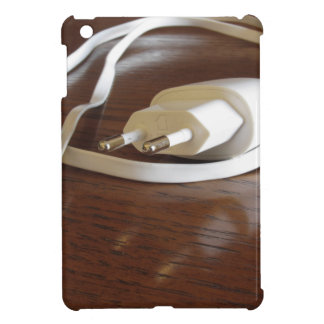 White smartphone charger on wooden table case for the iPad mini