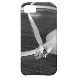 White smartphone charger on wooden table case for the iPhone 5