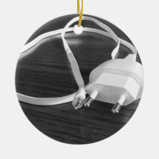 White smartphone charger on wooden table ceramic ornament