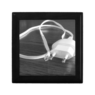 White smartphone charger on wooden table gift box
