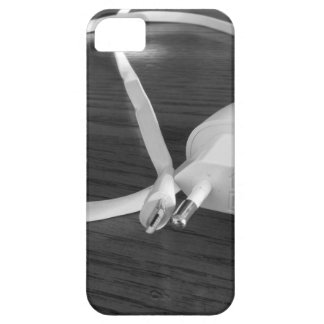 White smartphone charger on wooden table iPhone 5 case