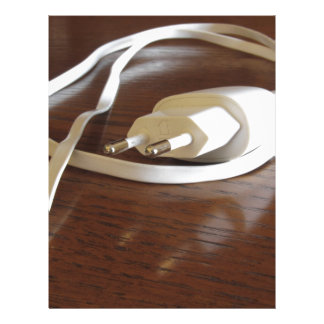 White smartphone charger on wooden table letterhead
