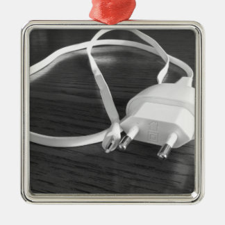 White smartphone charger on wooden table metal ornament