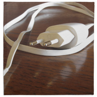 White smartphone charger on wooden table napkin