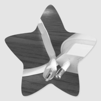 White smartphone charger on wooden table star sticker