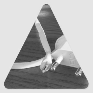 White smartphone charger on wooden table triangle sticker