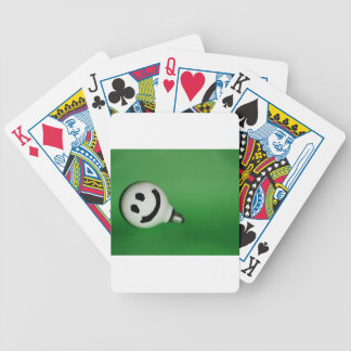White smiling bulb on green background bicycle playing cards