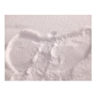 White snow imprinted with a snow angel postcard