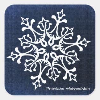 White Snowflake on Blue Fröhliche Weihnachten Square Sticker