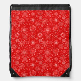 White Snowflakes on Christmas Red Drawstring Bag