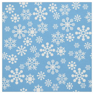 White snowflakes on light blue background Fabric