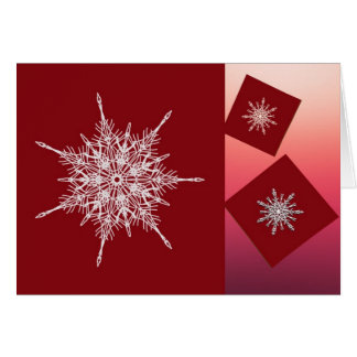 White snowflakes on red squares card