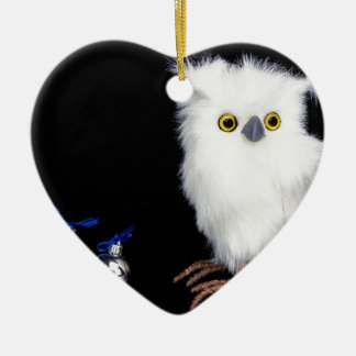 White snowy owl figurine with silver christmas ceramic ornament