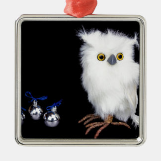 White snowy owl figurine with silver christmas metal ornament