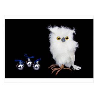 White snowy owl figurine with silver christmas postcard