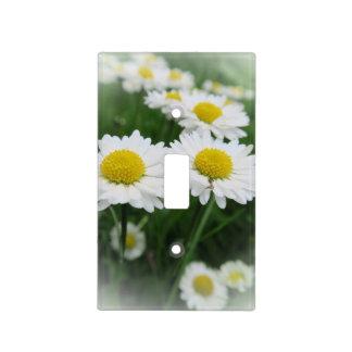 white spring flower in green grass light switch cover