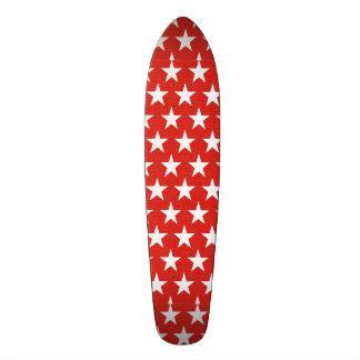 White stars on red background skate decks