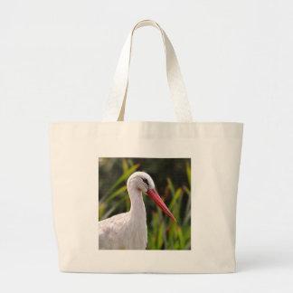 White stork among vegetation large tote bag