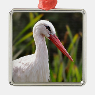 White stork among vegetation metal ornament