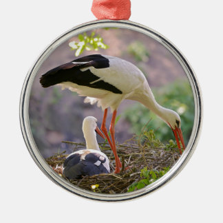 White storks on its nest metal ornament