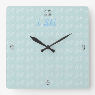 White Stylized Skiers Skiing and i. Ski. text Wall Clocks