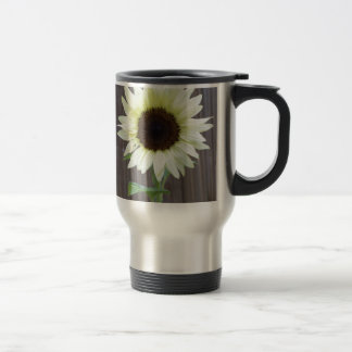 White sunflower against a weathered fence travel mug