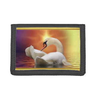 White Swan in a lake with a orange gold sunset Tri-fold Wallet
