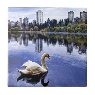 White Swan Swimming In The City Ceramic Tile