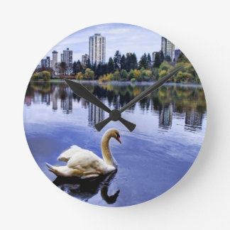 White Swan Swimming In The City Wall Clock