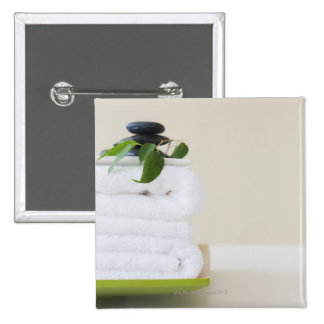 White towels and spa stones 2 inch square button