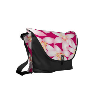 White tropical floral on pink courier bags
