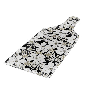 White tropical flowers on black cutting board