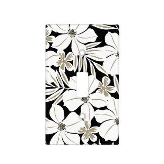 White tropical flowers on black light switch cover